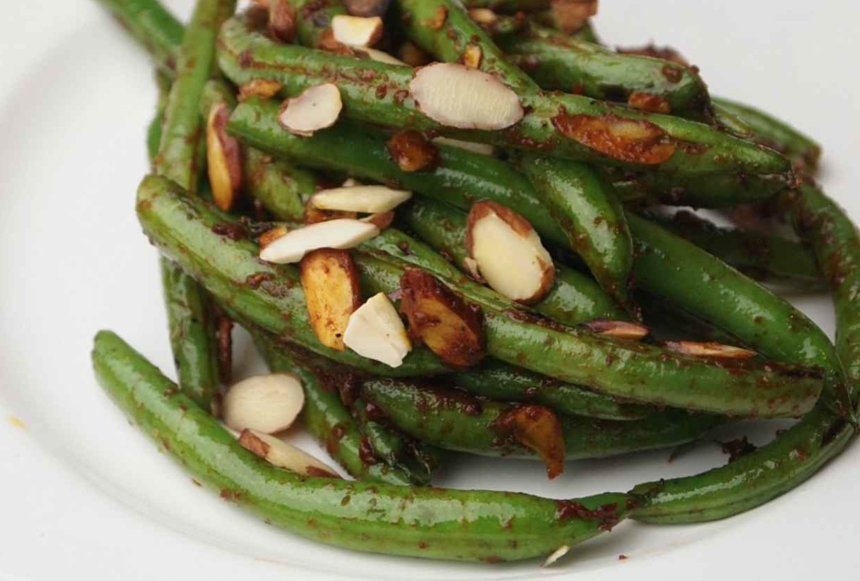 Joy of Kosher's Pan Charred Green Beans with Harissa and Almonds by Tamar Genger